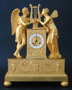 CHARLES AND REBEKAH CLARK - an empire figural clock - Horloge À Poser