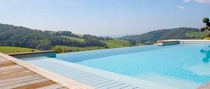 L'esprit Piscine - débordement - Traditioneller Swimmingpool