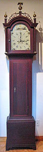 KIRTLAND H. CRUMP - cherry inlaid tall case clock - Standuhr
